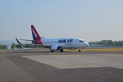 NAM Air flight is seen moving on airport runway in Indonesia Royalty Free Stock Photo