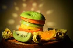 Nam de oranje de kiwicitroen van Apple toe stock afbeelding