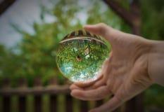Nam door een bruning glas toe royalty-vrije stock foto's