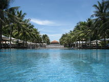 Nam Hai Pool 6. Photo of the olympic size pool at the nam hai resort in hoi an with the reception in the background Royalty Free Stock Images