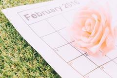 nam op de kalender toe Stock Foto