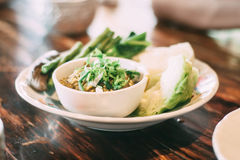 Nam Prik Num Northern Thai Green Chilli Dip with vegetables. On plate Stock Photo