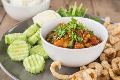 Nam Prik Ong , chili pork , Fried pork skin , Vegetable on woode Royalty Free Stock Photos