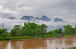 Nam Song river in Vang Vieng, Lao. After rain, under a mist Stock Photo