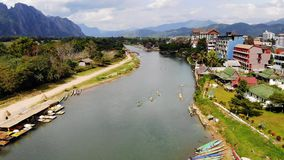 Nam Song River in Vang Vieng, Vientiane Province, Laos. Vang Vieng is a popular destination for adventure tourism in. A limestone karst landscape. top view stock footage