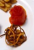 Nam van tomaten toe en bradend versier stock foto