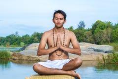 Namaskara by the river Stock Photography