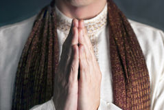 Namaste. A close-up shot of a man in traditional Indian clothing in the Namaste pose stock images
