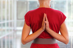Namaste gesture on back. Fit woman - namaste gesture on back - close up stock photo