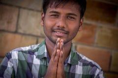 Namaste. Indian Student,Happy casual young student namaste pose stock images