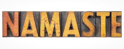 Namaste word abstract in wood type Stock Image