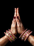 Namaste mudra. Woman hands with henna in Namaste mudra on black background royalty free stock photos