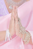 Namaste in pastel. Indian hands doing the namaste greeting, in pastel colors royalty free stock photo