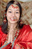 Namaste with a smile. Young Indian beauty giving the Namaste greeting from India stock photos