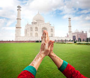 Namaste Taj Mahal. Woman hands with henna painting in Namaste gesture near Taj Mahal in Agra, Uttar Pradesh, India stock photo