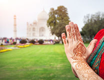 Namaste Taj Mahal. Woman hands with henna painting in Namaste gesture near Taj Mahal in Agra, Uttar Pradesh, India stock image
