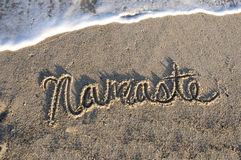 Namaste written in the sand Royalty Free Stock Images