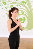 Namaste during yoga Stock Photography