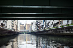 Namba resident buildings with canal under bridge. In Osaka, Japan Royalty Free Stock Photos
