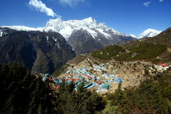 Namche Bazaar. Is a village in Solukhumbu District in the Sagarmatha Zone of north-eastern Nepal. It is located within the Khumbu area at 3,440 metres (11,286 stock photography