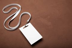 Name badge isolated on brown, copy space. Mock up.  stock photography