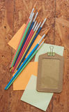 Name bag, post it and paintbrush Royalty Free Stock Images