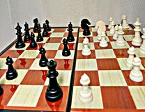 Chess is a table logic game with special figures on a 64-cell board for two rivals, combining elements of art in terms of chess c stock images