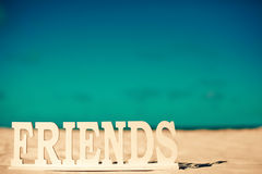 Name friends on white sand behind blue sky Stock Photos