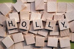 Name Holly in wooden cubes.