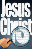 The name Jesus Christ under observation with magnifying glass Stock Image