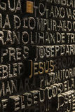 The name Jesus in a detail of a main door of the S royalty free stock images
