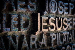 Name of Jesus written on the wall in cathedral. stock photos