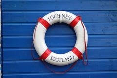Loch Ness name on life preserver. The name of Loch Ness on a life preserver ring on the shore of the lake in Scotland Royalty Free Stock Photo