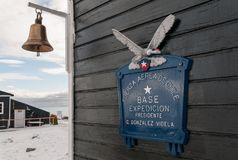 Name plaque and bell on living building, Gonzalez Videla Base, Antarctic Peninsula royalty free stock photos
