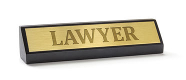Name plate on a white background with the engraving Lawyer Stock Image