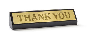 Name plate on a white background with the engraving Thank you Stock Photo