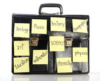 Name of school subjects stick on schoolbag Stock Photos