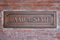 Name sign in copper of the Raad van State in the Netherlands. In English this means Supreme Administrative Court and is in The Hague stock photo