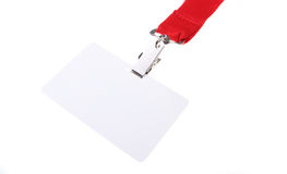 Name tag with red lanyard. Blank clip on name tag with red lanyard and copy space isolated on white background Royalty Free Stock Photos