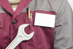 Name tag on uniform and wrench Royalty Free Stock Photo