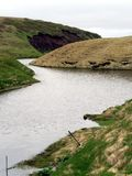 Nameless river, flowing through the lava fields in Hrifunes area in Iceland.  stock image