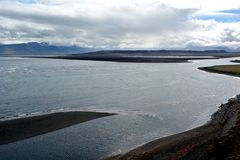 Nameless river, flowing through the lava fields in Hvitserkur area in Iceland.  royalty free stock photo