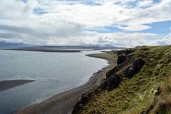 Nameless river, flowing through the lava fields in Hvitserkur area in Iceland.  stock image