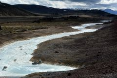 Nameless river, flowing through the lava fields in Iceland.  royalty free stock photography