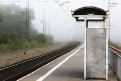 Nameless stopping railway platform early in the morning in the f stock images