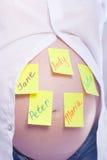 Namen en zwangerschap. Stock Foto's