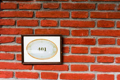 401 on nameplate against brick wall Royalty Free Stock Photography
