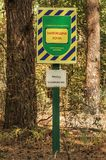 A nameplate with the inscription. `Reserved zone is protected by law of Ukraine` and `No road allowed` in the national park Stock Images