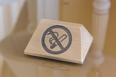 Nameplate with no smoking sign over the table. Nameplate with no smoking sign over the table Stock Photography