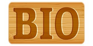 Nameplate of wood for menu with word BIO. Royalty Free Stock Photos